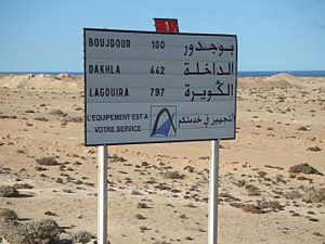 Demographics of Western Sahara - Bilingual road sign in French and Arabic, Western Sahara.
