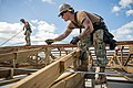 Seabees measure purlins on the roof of Tinian Elementary School. (30969747657).jpg