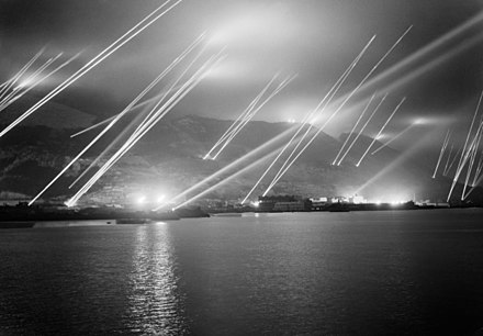 Searchlights on the Rock of Gibraltar during an air raid practice on 20 November 1942 Searchlights on the Rock of Gibraltar, 1942.jpg