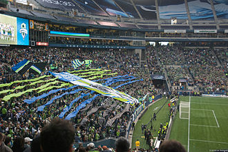 Seattle Sounders FC - Emerald City Supporters unveil a tifo prior to the club's inaugural match.