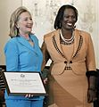 Secretary Clinton presents plaque to Sheila Roseau.jpg