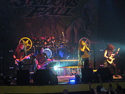 Shadows Fall performing in 2007. From left to right: Matt Bachand, Paul Romanko, Jason Bittner, Brian Fair, and Jonathan Donais.