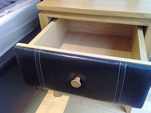 The side tables have convenient drawers and ma...