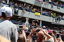 Crosby with the Stanley Cup during the Penguins' victory parade. The team won their fourth Stanley Cup championship in 2016.