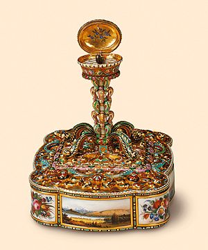"Singing bird box - ""Views of Switzerland"", Charles Abraham Bruguier, enamel attributed to Louis Dufaux père, 1840s. Gold, marble, mother-of-pearl and painted on enamel, ruby and emerald-set musical singing bird box in the form of a paperweight."