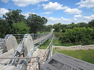 Souris, Manitoba - Bridge over the Souris River at Souris, Manitoba.  It spans 184  metres and has a weight capacity of 925 white-tailed deer. This bridge was built in 2013 to replace the bridge that was demolished in 2011 due to flooding. The first suspension bridge at Souris was erected in 1904.