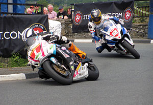 Michael Dunlop - Dunlop leading Guy Martin at Southern 100 road races in Isle of Man during 2012