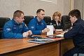 Soyuz MS-08 backup crewmembers listen to training instructors.jpg