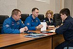 Soyuz MS-08 backup crewmembers listen to training instructors.jpg