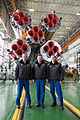 Soyuz TMA-07M crew in front of their booster rocket.jpg