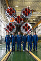 Soyuz TMA-19M crew and backup crew in front of the Soyuz booster rocket.jpg