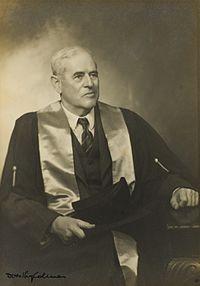 Studio portrait of Dr Errol Solomon Meyers wearing academic robes,1946.jpg