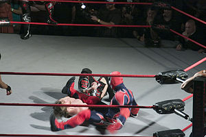 Suicide (wrestling) - Suicide performing a leg drop on Chris Sabin.