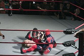 Suicide (wrestling) - Suicide performing a leg drop on Chris Sabin.