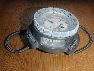 Diver navigation - Suunto SK-7 diving compass in aftermarket wrist mount with bungee straps