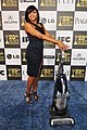 Taraji P. Henson with the LG Electronics Kompressor Vacuum on 25th Spirit Awards Blue Carpet held at Nokia Theatre L.A. Live on March 5, 2010 in LA.jpg