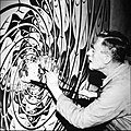 The Artist -Maurits Cornelelius Escher- working at his Atelier (50385403156).jpg