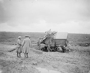 20th (Light) Division - 20th Division ambulance (the division sign is in front of the rear wheel), stuck in the mud near Guillemont, October 1916