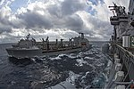 The amphibious assault ship USS Kearsarge (LHD 3), right, and the amphibious dock landing ship USS Carter Hall (LSD 50), background, conduct a replenishment at sea with the fleet replenishment oiler USNS Big 130314-N-SB587-024.jpg