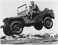 These soldiers go up in the air to prove that the Army's new quarter ton truck can take it. - NARA - 195336.tif
