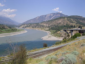 Lytton, British Columbia - The confluence of the Fraser and Thompson rivers showing the mixing of the two different coloured waters.  Botanie Mountain right background, Lillooet Ranges at left.