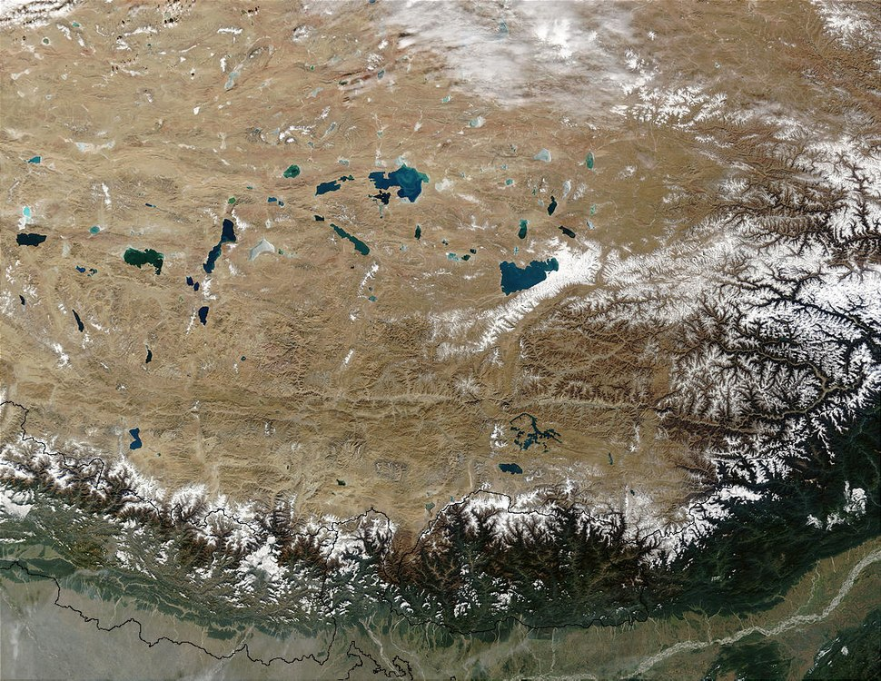Tibet-PHOTO-Satellite--NASA-Moderate Resolution Imaging Spectroradiometer(MODIS) show the high, arid, Tibetan Plateau in Asia. Tibet lies north of the Himalaya Mountains in Nepal---Tibet.A2002343.0445.1km