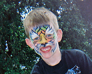 English: Child in Tiger face paint