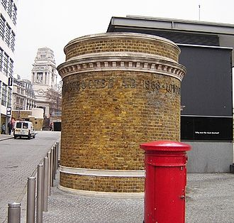 """Tower Subway - Tower Subway northern entrance 'kiosk' at Tower Hill. (January 2006). The lettering on the visible side reads """"CONSTRUCTED A.D. 1868 · LONDON""""."""