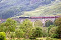 Train across Glenfinnan Viaduct (239397344).jpg