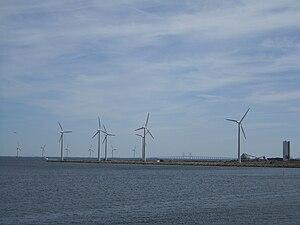Refshaleøen, Copenhagen - Windmills at Refshaleøen. Øresund Bridge in background.