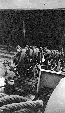 Troops board Kroonland at Saint-Nazaire, France, on 11 March 1919 to return to the United States. Troops loading on USS Kroonland, 11 March 1919.jpg