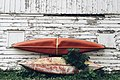 Two kayaks leaning on a wall (Unsplash).jpg