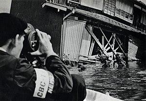Typhoon Vera - Japanese camera crew in a suburb of Nagoya in the wake of Typhoon Vera