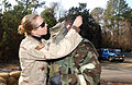 U.S. Air Force 437th Security Forces Squadron Staff Sgt. Jenae Shanks (left), adjusts the chemical warfare gas mask straps on Staff Sgt. Harold Darden, during chemical warfare orientation training at Charleston 050121-F-LI951-001.jpg