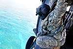 U.S. Army Sgt. 1st Class Darrell Williams, a UH-60 Black Hawk helicopter crew chief assigned to Bravo Company, 2nd Battalion, 25th Aviation Regiment, 25th Combat Aviation Brigade, observes Navy divers with 130618-A-UG106-232.jpg