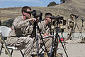 U.S. Marine Corps Cpl. Ryan Jung, left, and Sgt. Chris Hamilton, both scout snipers with the 1st Battalion, 1st Marine Regiment, spot New Zealand Army snipers, not shown, as they engage long-distance targets 130612-M-OM885-040.jpg