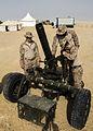 U.S. Marines assigned to Kilo Battery, Battalion Landing Team (BLT) 3-2, 26th Marine Expeditionary Unit (MEU), set up 120mm mortar systems in Al Galail, Qatar, April 23, 2013 130423-M-HF949-002.jpg