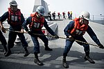 U.S. Sailors heave a line during an underway replenishment aboard the guided missile destroyer USS William P. Lawrence (DDG 110) Aug. 26, 2013, in the Arabian Sea 130826-N-ZQ631-015.jpg