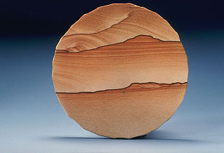 Sandstone A clastic sedimentary rock composed mostly of sand-sized particles