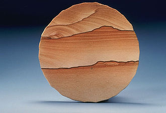 Sandstone - Cut slab of sandstone showing Liesegang banding