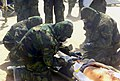 US Navy 030329-M-6910K-106 U.S. Navy Hospital Corpsmen treats a wounded Enemy Prisoner of War (EPW).jpg