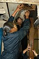 US Navy 030715-N-0021M-007 Mess Management Specialist 3rd Class Latonya Felton damage control team, works with 2nd Sgt. Willy Lim of the Republic of Singapore Navy (RSN) to erect shoring designed to control flooding during a tr.jpg