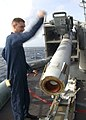US Navy 040126-N-7871M-002 Fire Controlman 3rd Class Matt Belanger from New Haven, Conn., assists in loading a NATO RIIM-7 Sea Sparrow missile aboard USS George Washington (CVN 73).jpg