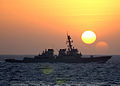 US Navy 040128-N-5405H-005 The guided missile destroyer USS Higgins (DDG 76) pulls away as the sun begins to set in the region,.jpg