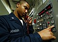 US Navy 040210-N-6278K-001 Information Systems Technician 3rd Class Anthony Dowden from Brooklyn, N.Y., conducts a communications check on a UHF circuit aboard USS George Washington (CVN 73).jpg