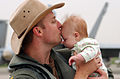 US Navy 040522-N-0435H-001 Lt. Cmdr Sean Cushing kisses his daughter after his return from a deployment.jpg