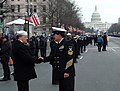 US Navy 050120-N-0962S-044 Master Chief Petty Officer of the Navy (MCPON) Terry Scott shakes hands with one of the hundreds of Sailors who helped line the street cordon down Pennsylvania Avenue for the Inauguration Day Parade.jpg