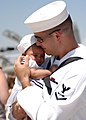 US Navy 050731-N-6367N-027 A Sailor hold his child for the first time after returning from a six-month deployment.jpg