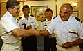 US Navy 050805-F-4883S-005 Master Chief Petty Officer of the Navy (MCPON) Terry D. Scott, left, shares a light moment with Command Master Chief Carlos Arayor, of the Chilean Fast Frigate Almirante Williams (FF 19).jpg