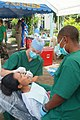 US Navy 050819-N-4772B-071 U.S. Navy dentist, Lt. Adrian F. LePendu and Dental Technician 3rd Class Cassandra M. Herring, treat a patient during a combined medical and dental civic action.jpg